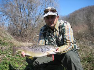 Vassil Stoilov with a nice trout caught with his handcraft lure